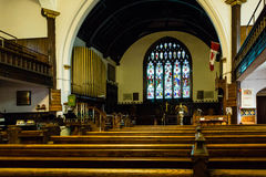 Pews and Stained Glass in Canadian Church Stock Photos
