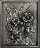 Pewter bas-relief Bouquet. Pewter bas-relief with frame The bouquet with poppy and ears  on a white background Stock Photo