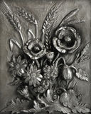 Pewter bas-relief Bouquet. Pewter bas-relief  The bouquet with poppy and ears  on a white background Royalty Free Stock Photos