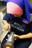 Pewter designer, Kuala Lumpur, Malaysia. Picture of a Pewter designer using small hammer in Royal Selangor, Kuala Lumpur, Malaysia Stock Images