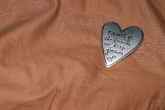 Pewter heart on brown blanket. A pewter heat on a brown blanket Royalty Free Stock Images