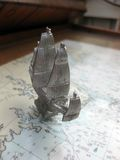 Pewter Ship Model on a Nautical Chart Stock Photo