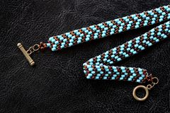 Peyote choker necklace made of seed beads on a dark background. Close up royalty free stock photos