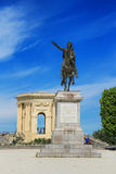 Peyrou Garden in Montpellier, France. MONTPELLIER, FRANCE – MAY 27, 2014: Arc de Triomphe and Statue of Louis XIV on horseback, in Peyrou Garden in Montpellier Stock Photography