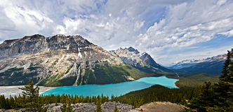 Peyto lake. Scenic view of Peyto lake under cloudscape, Banff National Park, Canadian Rocky Mountains royalty free stock photos