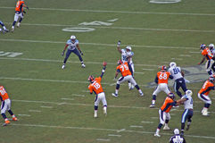 Peyton manning passes. Peyton manning releases a long pass towards decker against the tiatns royalty free stock photos