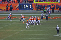 Peyton passes. Peyton manning sets up to pass into the endzone stock image