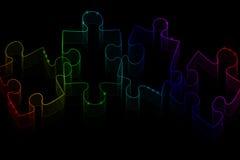 Pezzi al neon di puzzle Fotografia Stock Libera da Diritti