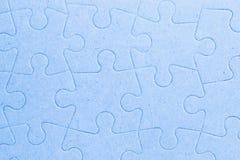 Pezzi in bianco collegati del puzzle come fondo Immagine Stock