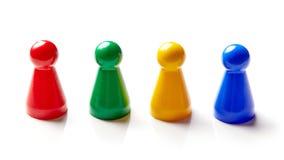 Pezzi colorati del gioco da tavolo isolati su bianco Fotografia Stock Libera da Diritti