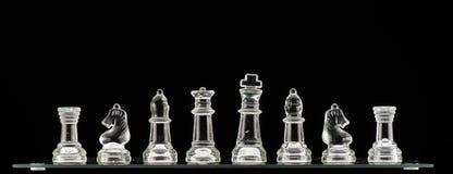 Pezzi degli scacchi del vetro trasparente Immagine Stock