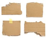 Pezzi del cartone su bianco Fotografia Stock Libera da Diritti