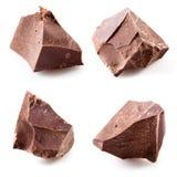 Pezzi del cioccolato isolati accumulazione Immagini Stock Libere da Diritti