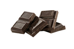 Pezzi del cioccolato isolati su fondo bianco Fotografia Stock Libera da Diritti