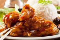 Pezzi del pollo fritto con salsa agrodolce Fotografia Stock
