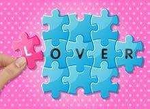 Pezzi del puzzle con l'amante di parole Immagine Stock Libera da Diritti