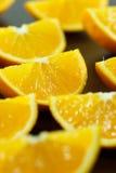 Pezzi di arancia su un fondo di legno Immagini Stock Libere da Diritti