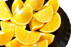 Pezzi di arancia su una banda nera Fotografia Stock Libera da Diritti