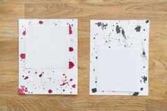 Pezzi di carta con le gocce dell'inchiostro Fotografia Stock