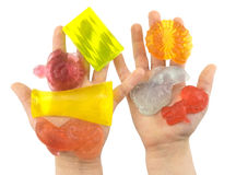 Pezzi di colore di sapone fatti a mano in palme dei bambini Fotografia Stock Libera da Diritti