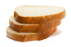 Pezzi di pane bianco isolati su fondo bianco Fotografie Stock Libere da Diritti