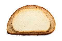 Pezzi di pane differente isolati su fondo bianco fotografia stock