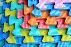 Pezzi di plastica del puzzle dei bambini del ritaglio Immagine Stock
