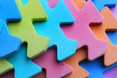 Pezzi di plastica del puzzle dei bambini del ritaglio Fotografia Stock