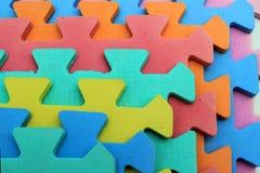 Pezzi di plastica del puzzle dei bambini del ritaglio Fotografia Stock Libera da Diritti