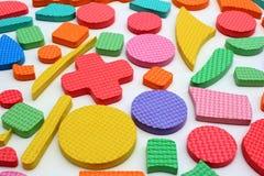 Pezzi di plastica di puzzle dei bambini del ritaglio Fotografia Stock Libera da Diritti