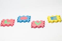 Pezzi di puzzle con amore di parola Fotografia Stock
