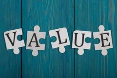 Pezzi di puzzle con la parola fotografia stock