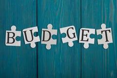 Pezzi di puzzle con la parola & x22; Budget& x22; Fotografie Stock Libere da Diritti