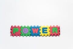 Pezzi di puzzle con potere di parola immagini stock