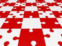 Pezzi di puzzle in rosso ed in bianco Fotografia Stock