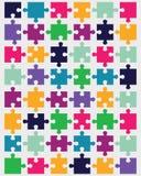 pezzi di puzzle variopinto Fotografie Stock
