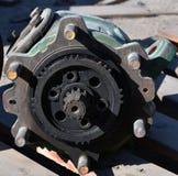 Pezzi di ricambio di ruota di ingranaggio sulla pompa a ingranaggi idraulica del trattore fotografie stock libere da diritti