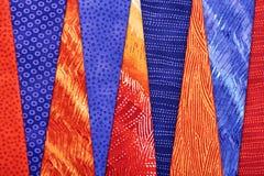 Pezzi di tessuti imbottenti che si trovano sopra a vicenda Immagine Stock Libera da Diritti