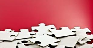 Pezzi sparsi del puzzle Fotografia Stock
