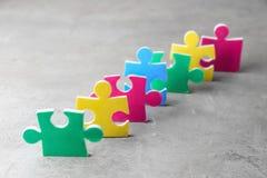 Pezzi variopinti di puzzle Fotografia Stock