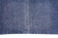 Pezzo di tessuto blu scuro dei jeans Fotografia Stock