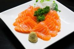 Pezzo e wasabi di color salmone Immagine Stock