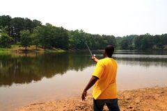 Pezzo fuso del pescatore fotografia stock libera da diritti