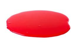 Pfütze eines roten Farbenflecken Lizenzfreies Stockbild