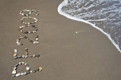 ?pf 2009 ' in het zandige strand Stock Fotografie