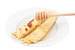 Pfannkuchen mit Honig stockfotos