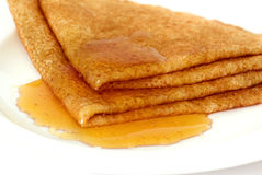 Pfannkuchen mit Honig Stockbild