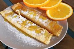 Pfannkuchen mit Orangen Stockbild