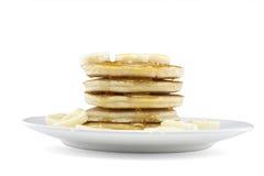 Pfannkuchen mit Sirup und Banane stockbilder