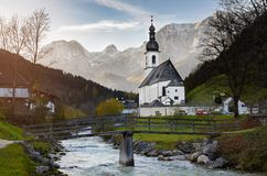 Pfarrkirche St. Sebastian, Bayern, Deutschland. Autumn view of St. Sebastian parish church against Reiter Aple, Bavaria, Germany Stock Image